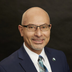 Portriat Photo Image of Commissioner Loginos Gonzalez Jr